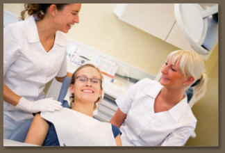 happy dental patient with nurses
